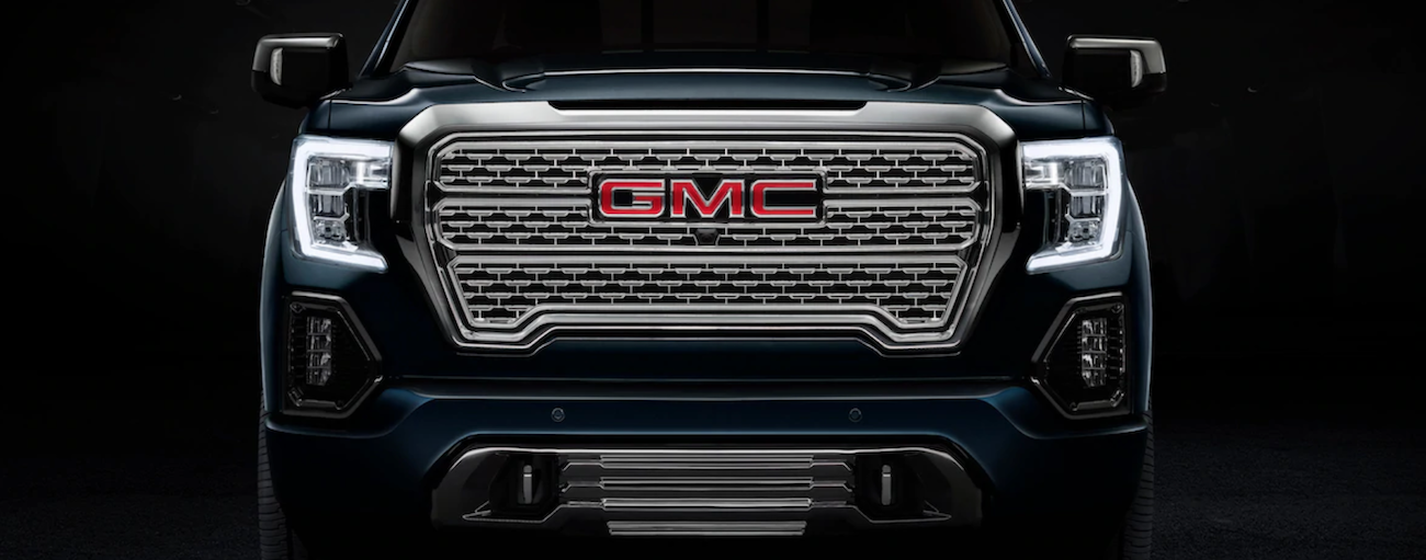 The chrome grill of a black 2019 GMC Sierra