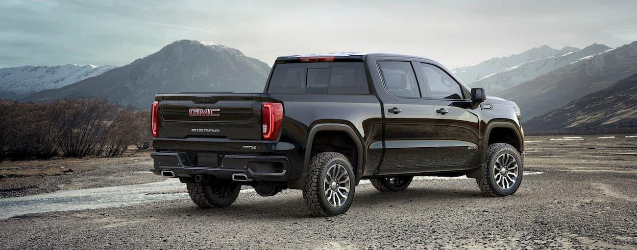 A black 2019 GMC Sierra 1500 overlooking a mountain range
