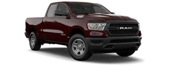 A red 2019 Ram 1500 facing right on white