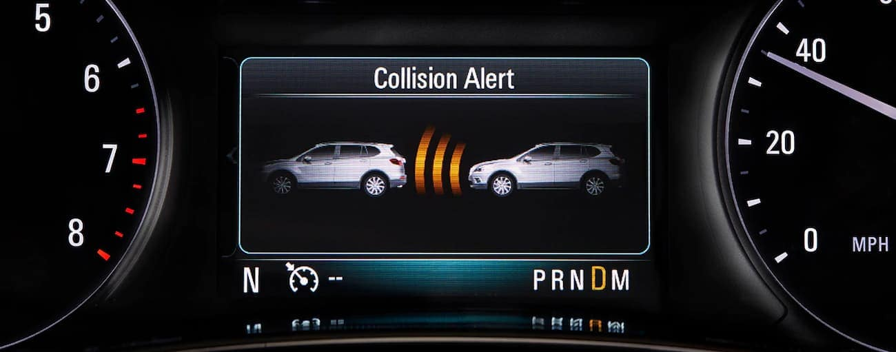 The collision alert warning on the dash of a 2019 Buick Encore is shown. Check out safety when comparing the 2019 Buick Encore vs 2019 Mini Countryman in Atlanta, GA.