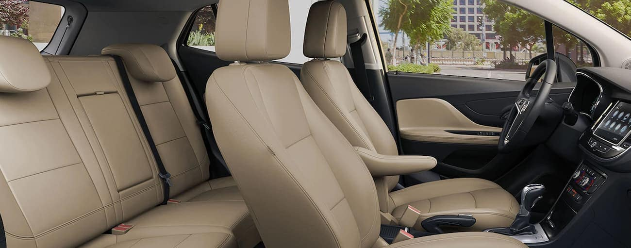 The tan interior of a 2019 Buick Encore is shown. Check out entertainment when comparing the 2019 Buick Encore vs 2019 Mini Countryman in Atlanta, GA.