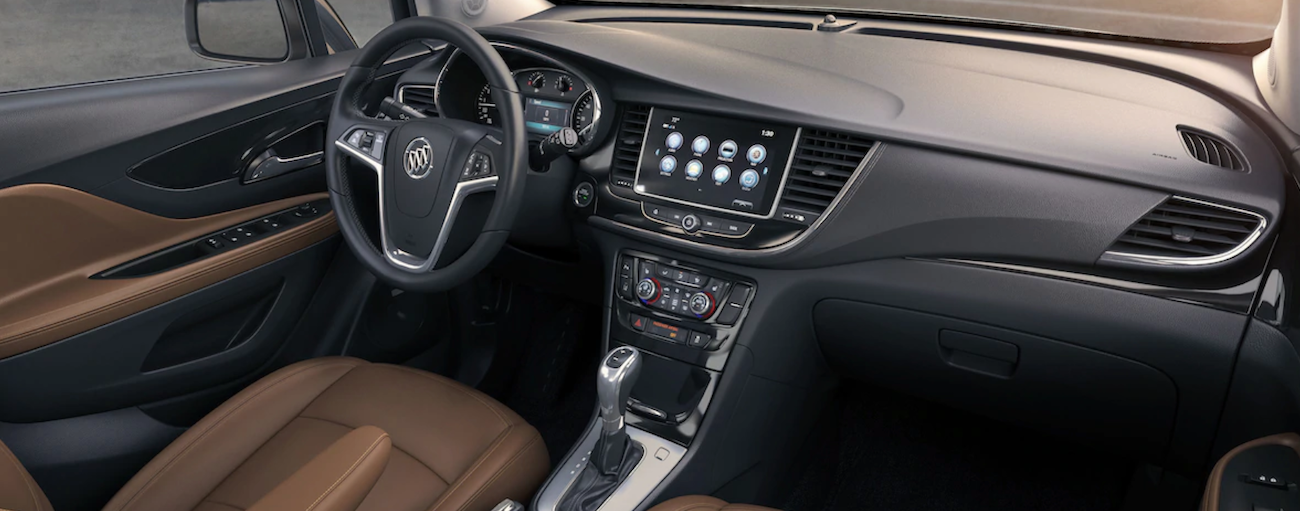 The black and tan interior in this 2019 Buick Encore features better technology when comparing the 2019 Buick Encore vs 2019 Nissan Kicks.