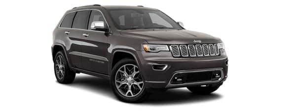 A dark grey 2019 Jeep Grand Cherokee is facing right.