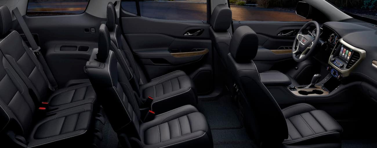 The black interior of a 2019 GMC Acadia is shown, which wins when comparing the 2019 GMC Acadia vs 2019 Jeep Grand Cherokee.