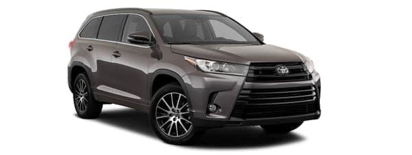 A dark grey 2019 Toyota Highlander is facing right.