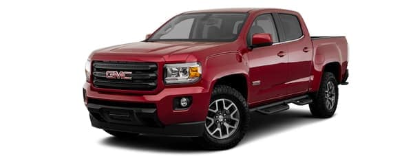 A red 2019 GMC Canyon is facing left.