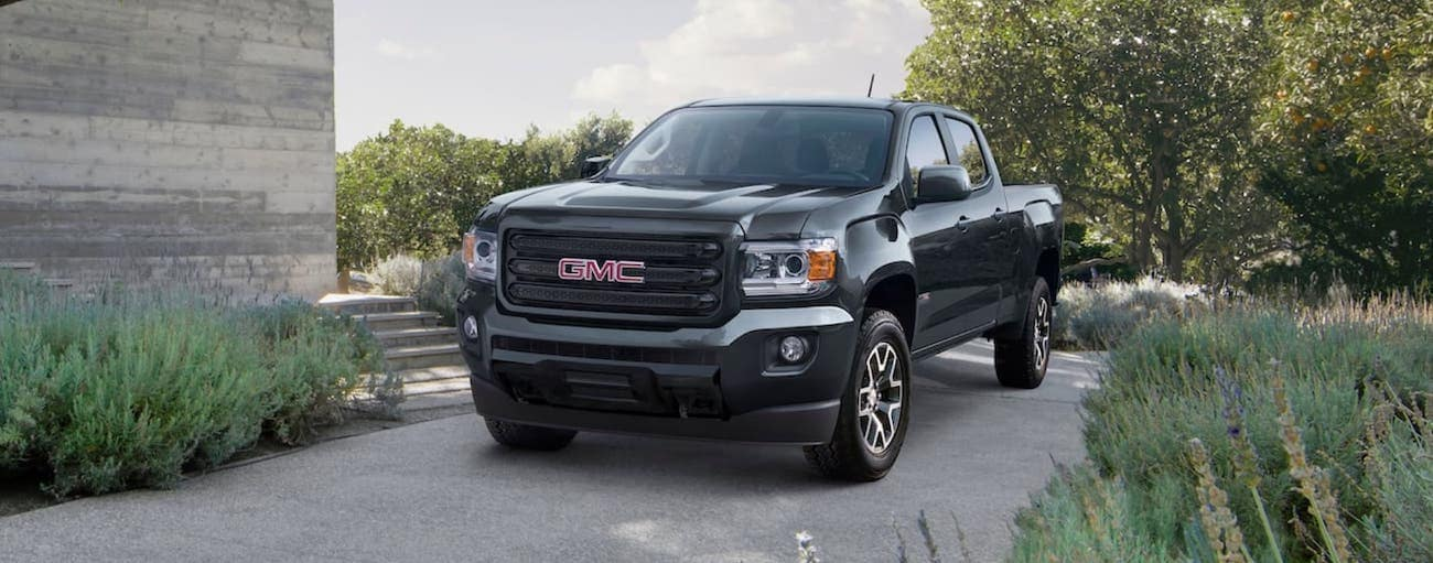 A black 2019 GMC Canyon is parked in a driveway outside Atlanta, GA.
