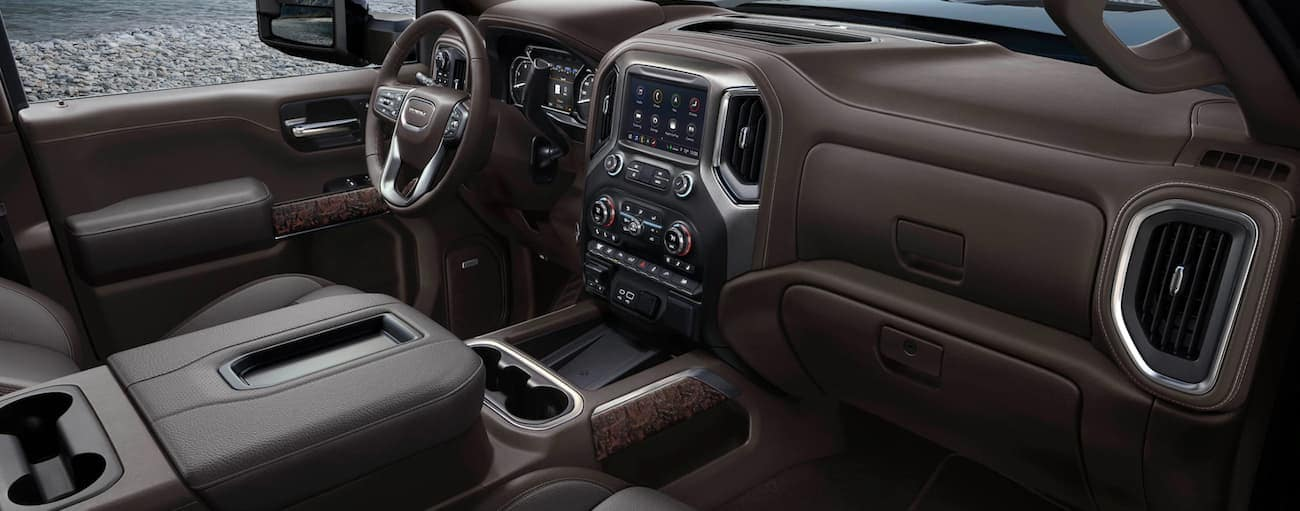 The front brown leather interior of a 2020 GMC Sierra 2500HD is shown.