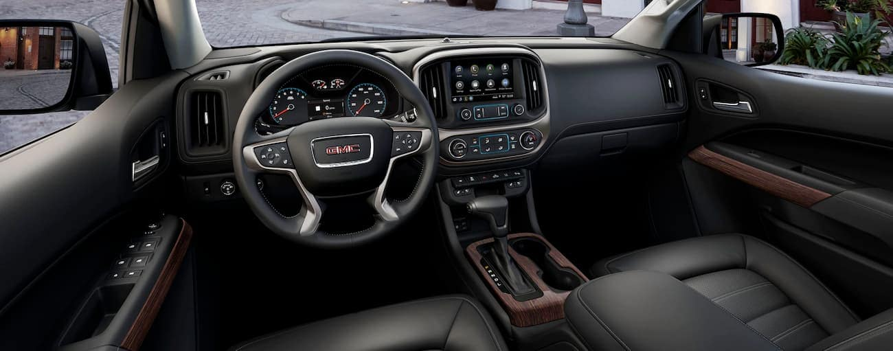 The black interior of a 2019 GMC Canyon is shown.