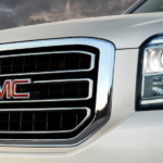 The front end of a white 2019 GMC Yukon is shown.