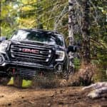A black 2019 GMC Sierra 1500 AT4 is on a trail after leaving a GMC dealer near me.