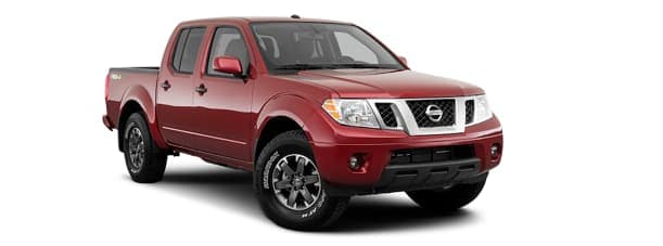 A red 2019 Nissan Frontier is facing right.