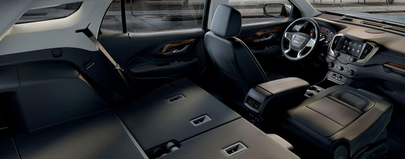 The back seats of a 2019 GMC Terrain are folded down.