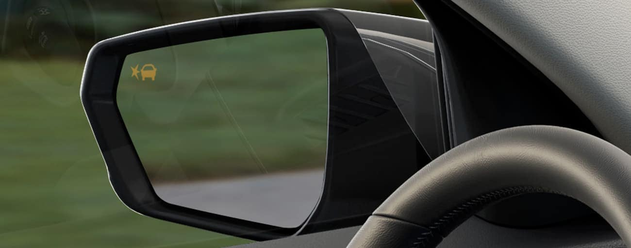 The warning light on the mirror of a 2019 GMC Terrain is on.