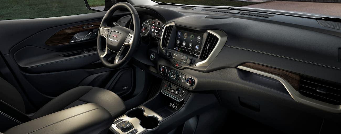 The black interior of a 2019 GMC Terrain is shown, which wins when comparing the 2019 GMC Terrain vs 2019 Toyota RAV4.