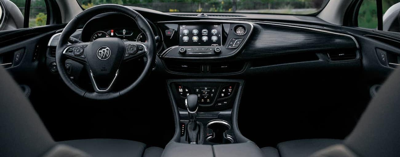 The black interior of a 2020 Buick Envision is shown.