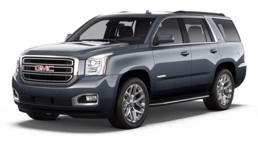 A grey 2020 GMC Yukon is facing left.