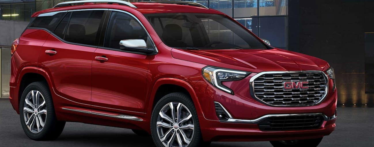 A red 2019 GMC Terrain which wins when comparing the 2019 GMC Terrain vs 2019 Jeep Compass, is parked in a parking lot near Atlanta, GA.