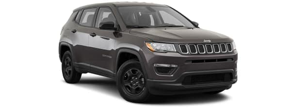 A green 2019 Jeep Cherokee is facing right.