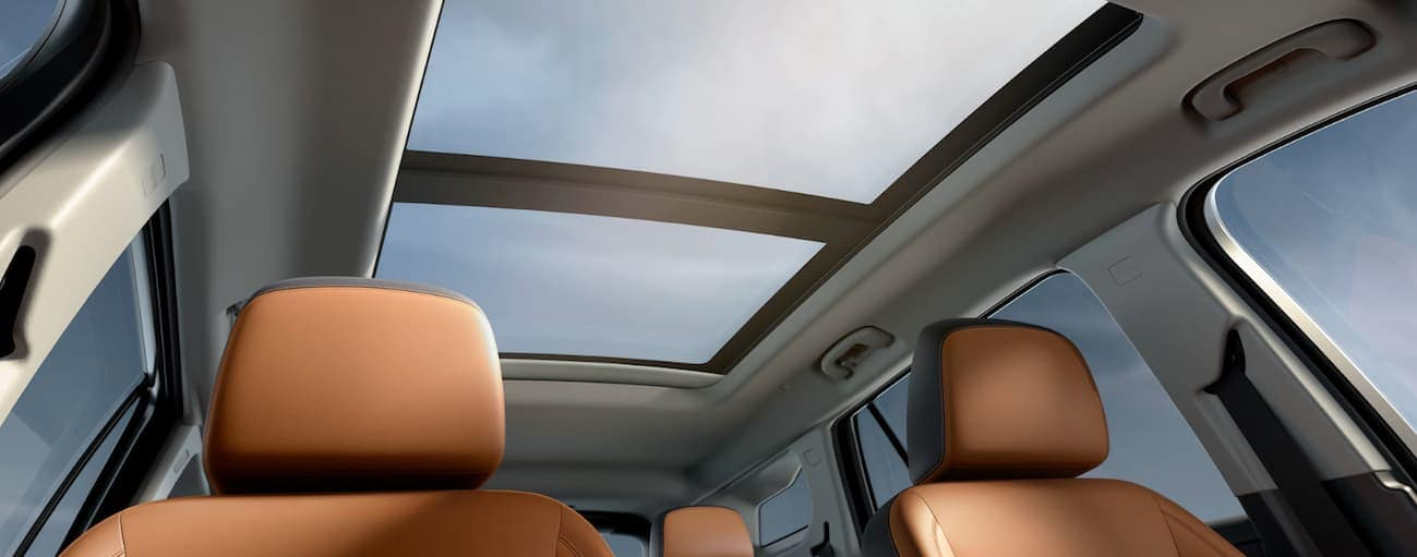 The available SkyScape Sunroof with brown and black leather interior is shown in the 2019 GMC Terrain.