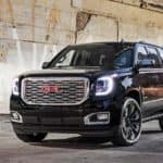 A black 2018 GMC Yukon is parked under a bridge near Atlanta, GA.