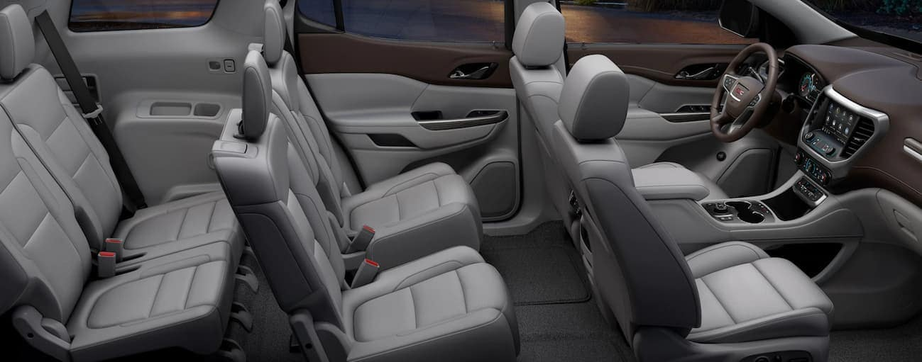 A birds eye view of the grey interior of a 2020 GMC Acadia is shown.