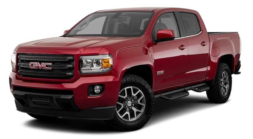 A red 2020 GMC Canyon is facing left.