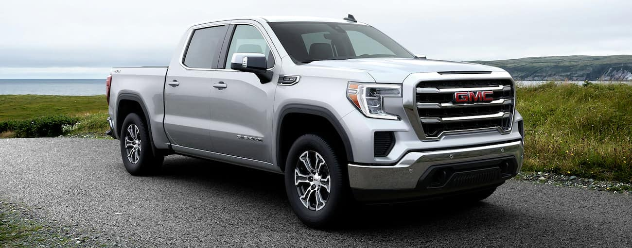 A silver 2020 GMC Sierra 1500 SLE is shown with wheel upgrades.