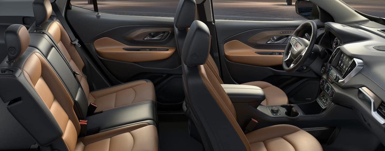 A side view of the brown and black leather interior of a 2020 GMC Terrain is shown.
