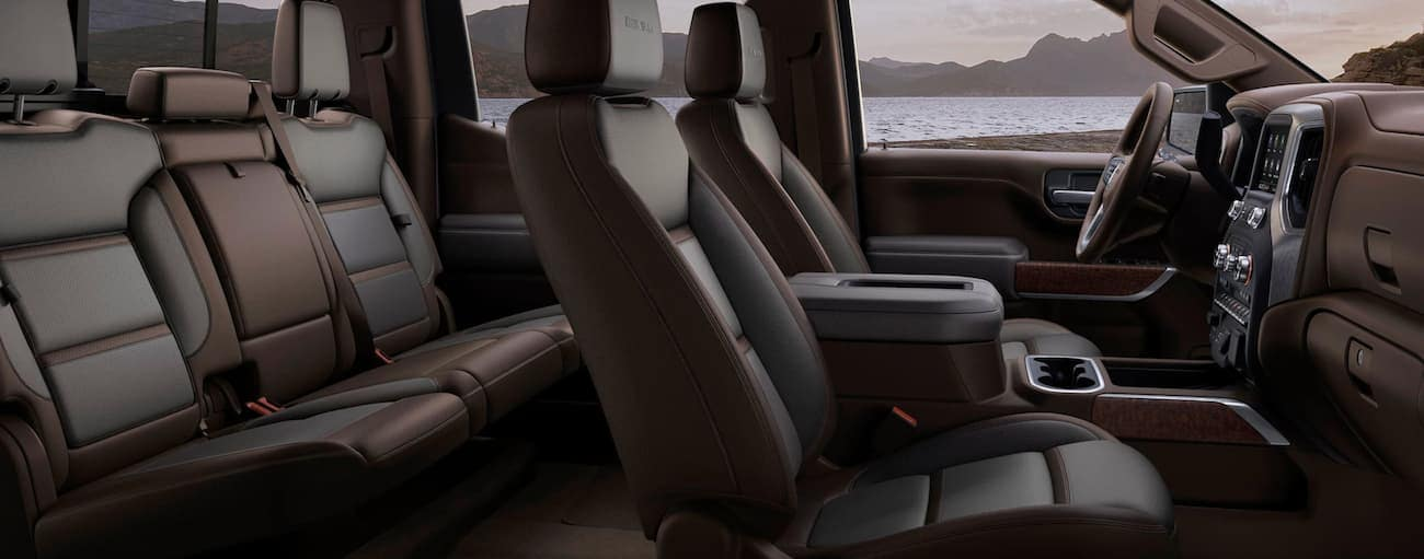 A side view of the brown and black leather interior of the 2020 GMC Sierra 1500 is shown.