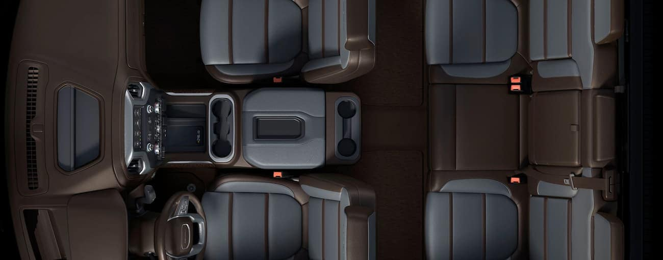 A birds eye view of the brown and grey interior of a 2020 GMC Sierra 1500 is shown.