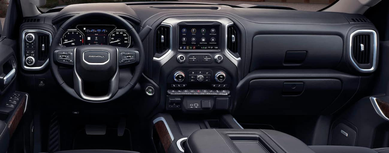 A view of the front black leather interior of a 2020 GMC Sierra 1500 is shown.