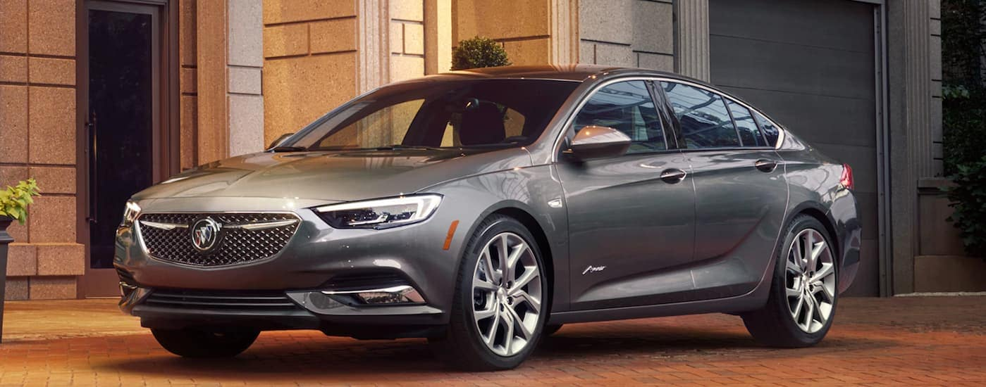 A 2020 Buick Regal Avenir is parked in front of a brick building near Duluth, GA.