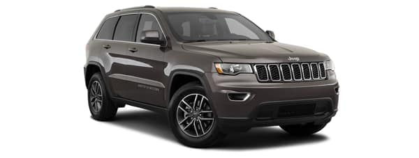 A grey 2020 Jeep Grand Cherokee is facing right.