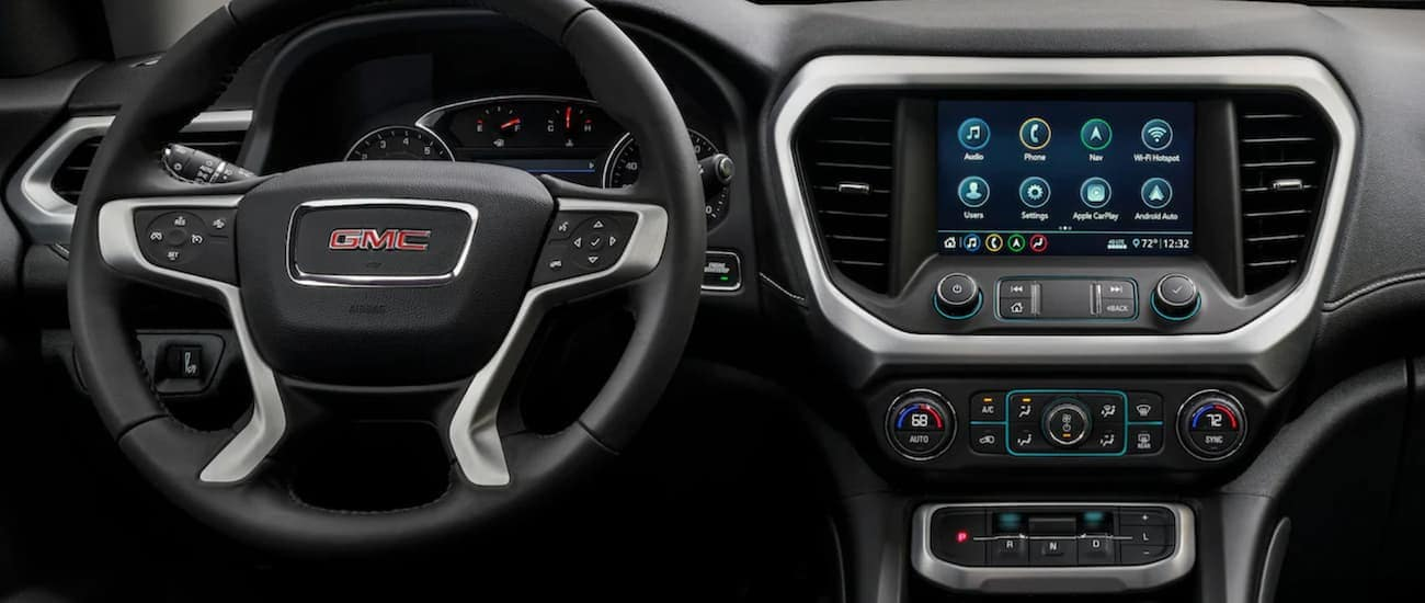 A close up of the infotainment system and driver's display of a 2020 GMC Acadia is shown.