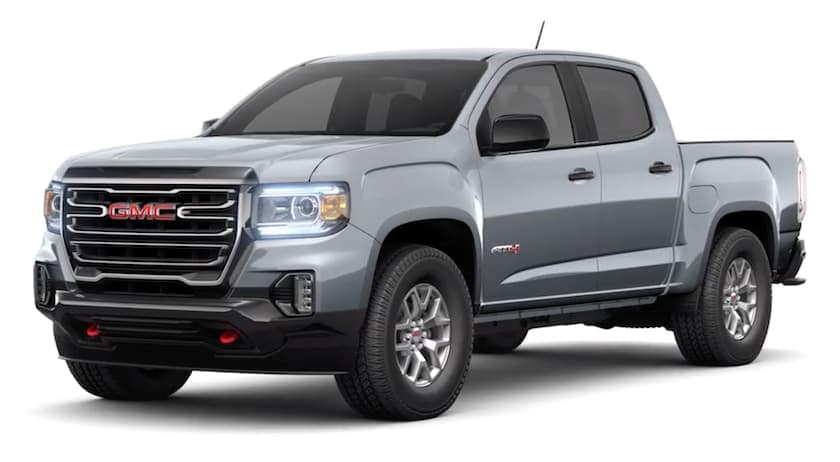 A grey 2021 GMC Canyon is facing left.