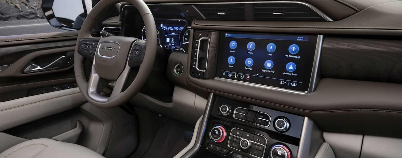 The tan and brown interior of a 2021 GMC Yukon is shown.