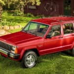 A red 1984 Jeep Cherokee is parked in front of cabin outside of Atlanta, GA.