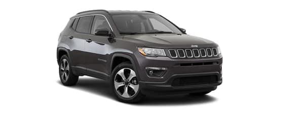 A dark grey 2020 Jeep Compass is facing right.