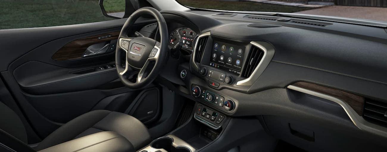 The black interior of a 2020 GMC Terrain is shown.