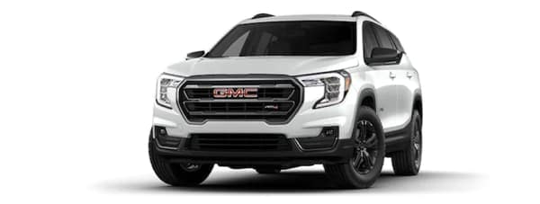 A white 2021 GMC Terrain AT4 is facing left.