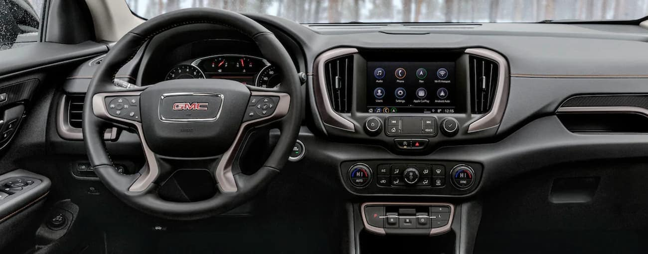 The dashboard and infotainment screen in the 2021 GMC Terrain is shown, which wins when comparing the 2021 GMC Terrain vs 2020 GMC Terrain in Atlanta, GA.
