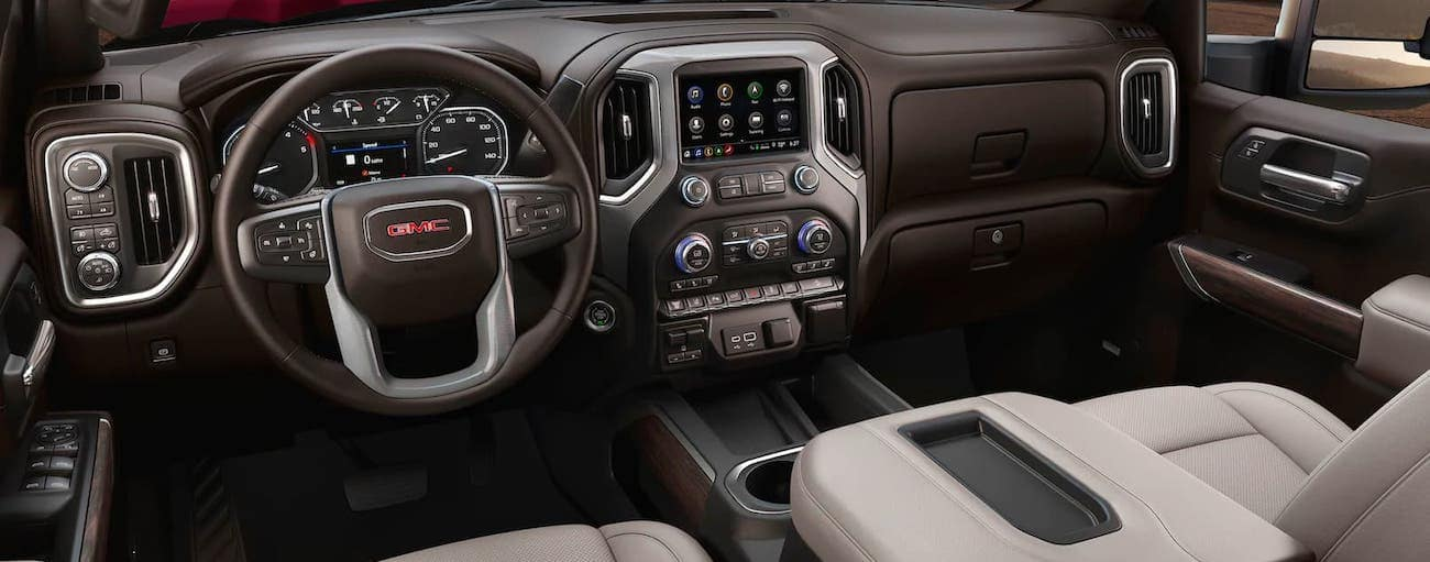 The light gray and brown interior is shown in a 2020 GMC Sierra 2500, see one at your local Atlanta GMC dealer.