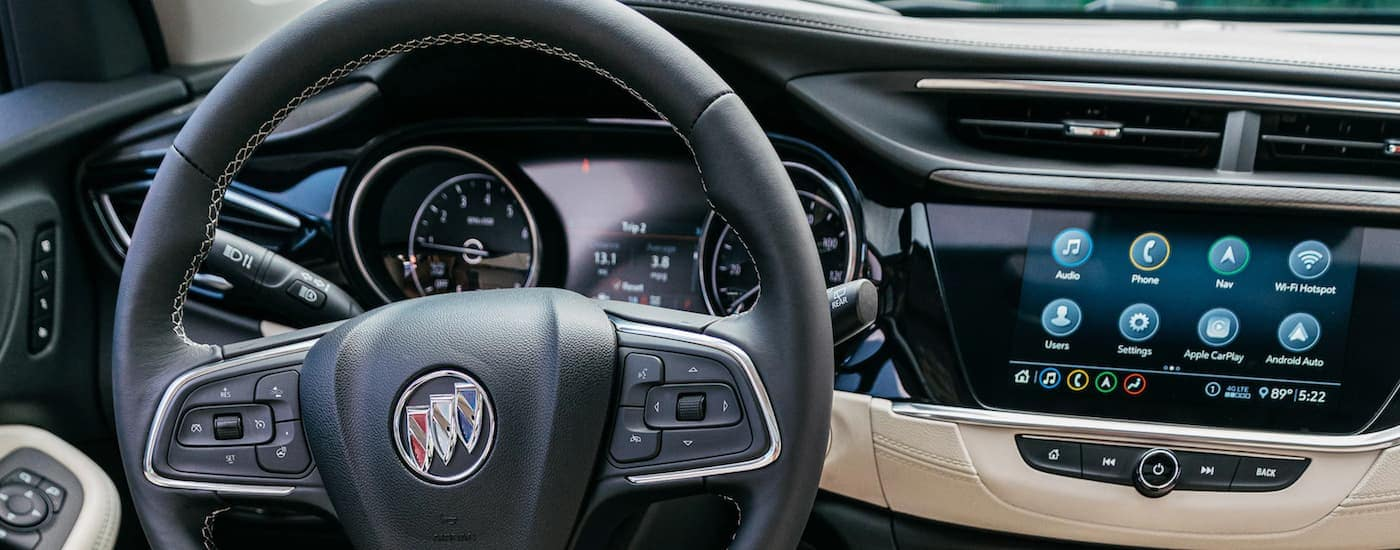 The black and tan dashboard of a 2020 Buick Encore GX is shown.