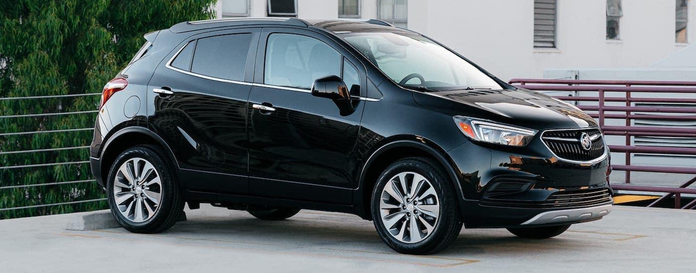 A black 2020 Buick Encore is parked in an open-air parking garage near Atlanta, GA.