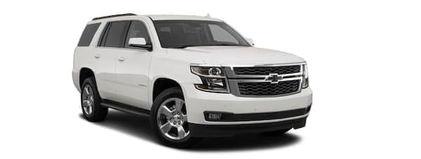 A white 2020 Chevy Tahoe is angled right.