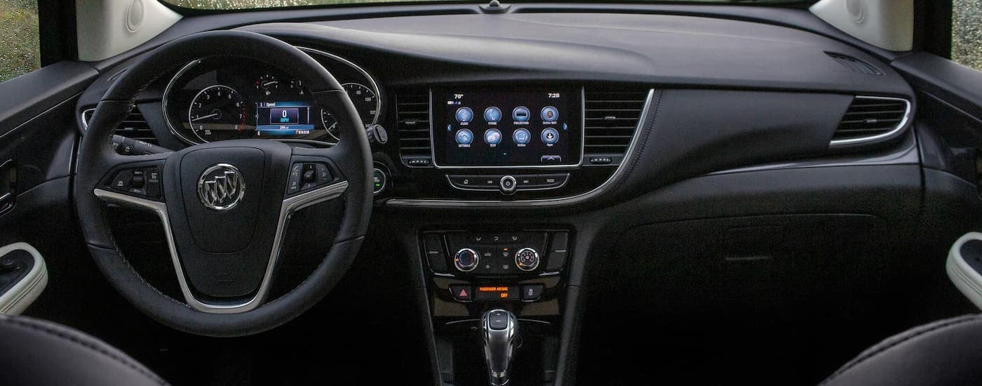 The interior and infotainment screen inside a 2020 Buick Encore is shown, the winner of the 2020 Buick Encore vs 2020 Ford EcoSport comparison.