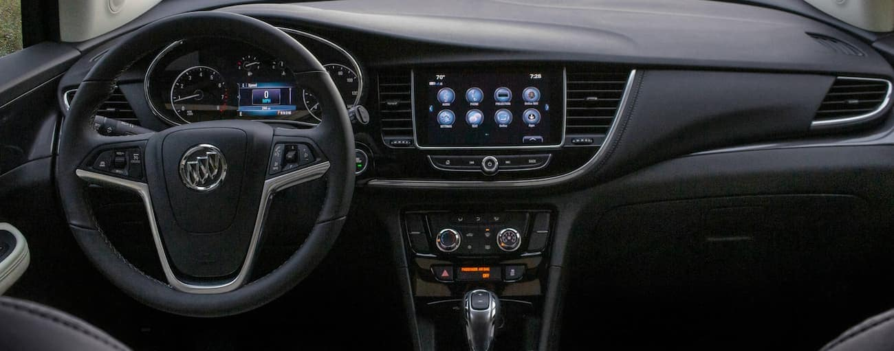 The dashboard and tech features of a 2020 Buick Encore are shown.