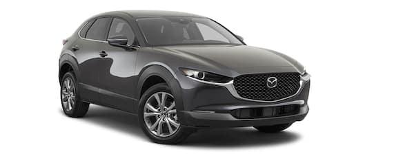 A black 2020 Mazda CX-30 is facing right.