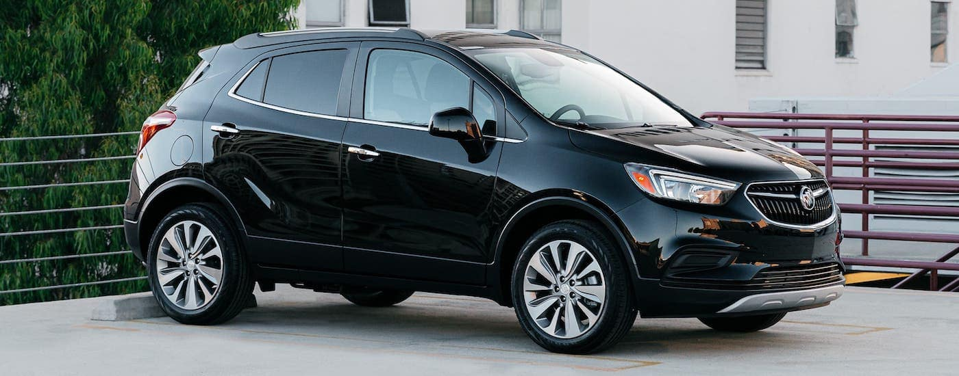 A black 2020 Buick Encore is parked in an empty lot after winning the 2020 Buick Encore vs 2020 Nissan Kicks comparison.